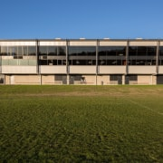 The new ACG Gymnasium enjoys a broad view architecture, building, campus, corporate headquarters, daytime, facade, grass, house, real estate, sky, structure, brown, teal