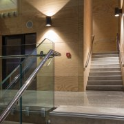 The entry foyer in the new ACG Gymnasium architecture, daylighting, floor, glass, handrail, interior design, lobby, stairs, brown, black, gray