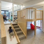 The Cosmokids premises spread across a heritage building floor, flooring, furniture, hardwood, interior design, stairs, table, wood, gray