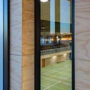 A glimpse from the entry stairs into the architecture, daylighting, door, glass, structure, window, gray
