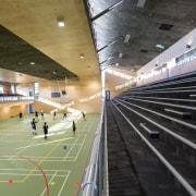 Bleachers provide a birds eye view of sporting airport terminal, architecture, infrastructure, leisure centre, metropolitan area, sport venue, structure, black