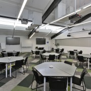 Operable walls allow various size configurations of the classroom, interior design, gray