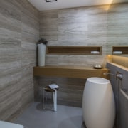 External travertine cladding extends into a powder room architecture, bathroom, interior design, room, wall, gray