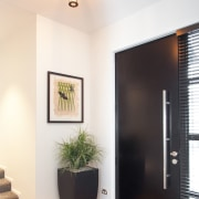 This entry opens directly into the hallway that ceiling, door, home, house, interior design, light fixture, lighting, wall, white