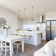 The kitchen in this Fowler Homes showhome is dining room, home, interior design, living room, property, real estate, room, white