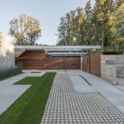 The driveway to this renovated and extended property architecture, backyard, courtyard, estate, facade, grass, house, landscape, property, real estate, residential area, walkway, yard, gray