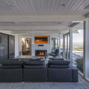 During the renovation and addition to this Mid-century home, house, interior design, living room, real estate, gray