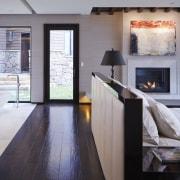 Designer Mick De Giulio says having such an fireplace, floor, flooring, hardwood, hearth, home, house, interior design, living room, room, window, wood, wood flooring, gray