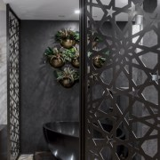 Powder-coated, laser-cut screens in a bronze finish bring glass, interior design, wall, black, gray