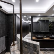 An exotic tapestry of porcelain tiles, Platinum Travertine bathroom, ceiling, countertop, interior design, black, gray