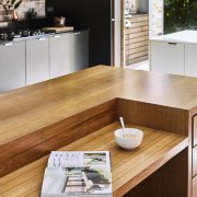 Recycled Tasmanian oak was used to craft this countertop, floor, flooring, furniture, hardwood, interior design, kitchen, product design, table, wood, wood flooring, orange