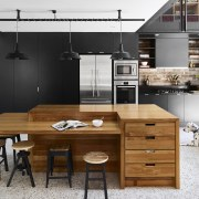 Cool-toned concrete floors and matt black cabinetry are countertop, cuisine classique, furniture, interior design, kitchen, table, white, black