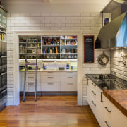 A custom ladder and hook access system is cabinetry, countertop, interior design, kitchen, brown, gray