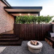 A privacy wall between a new outdoor area architecture, courtyard, facade, home, house, outdoor structure, property, real estate, residential area, roof, black, white