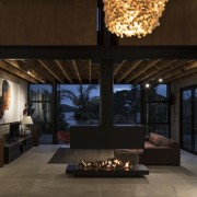 A poured concrete floor and the precast concrete interior design, living room, black, tiles, Vaughn McQuarrie Architects