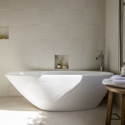 Raised wall tiles are laid in an alternating bathroom, bathroom sink, bidet, ceramic, floor, flooring, interior design, plumbing fixture, product design, sink, tap, tile, wall, gray
