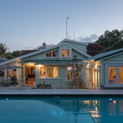 A lean-to addition at the back of this cottage, estate, facade, home, house, mansion, property, real estate, reflection, residential area, resort, roof, siding, swimming pool, villa, teal, gray