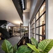 The entry approach to this renovated home has architecture, home, house, interior design, lobby, Phongphat, Anonym Studio, entrance, metal staircase
