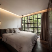 Architect Phongphat Ueasangkhomset of Anonym Studio repurposed this architecture, bedroom, home, interior design, suite, wall, window, wood, Phongphat, Anonyum Studio, entranceway, joinery