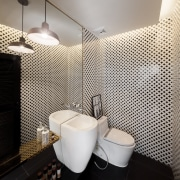 This eye-catching powder room is part of a bathroom, ceramic, flooring, interior design, toilet, basin, tile, renovated bathroom