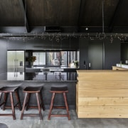 An untreated macrocarpa upstand is a feature of countertop, furniture, interior design, kitchen, table, black, gray