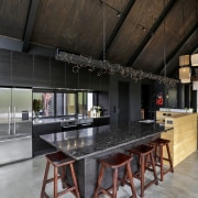 A suspended steel girder over this kitchen by architecture, house, interior design, table, black, gray