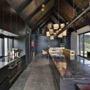 A black understated island benchtop, black-stained veneer cabinetry architecture, countertop, house, interior design, kitchen, loft, black, gray