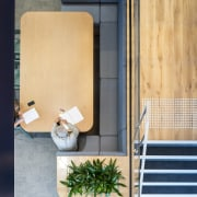 A large stairwell is a key part of architecture, furniture, house, product design, table, orange, gray