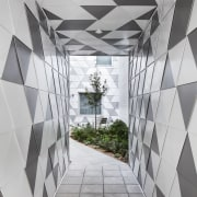 Accessways into this new inner-city apartment block are angle, architecture, black and white, building, ceiling, daylighting, design, interior design, line, pattern, structure, gray