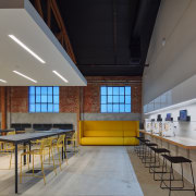 Architect Cory Grosser has introduced elegant casual seating architecture, ceiling, classroom, daylighting, interior design, table, gray