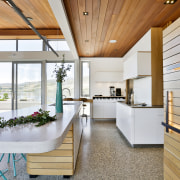 Designer Melanie Craig took a fresh approach in architecture, white kitchen, concrete, floor, corian, benchtop, Melanie Craign Design
