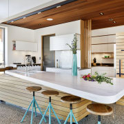 This kitchen by designer Melanie Craig is divided architecture, countertop, kitchen, polished concrete, floor, Melanie Craig Design, contemporary, Corian,