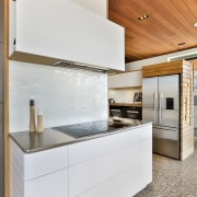 Placing the fridge in the opening to this cabinetry, countertop, classique, , kitchen, white, Melanie Craig Design, polished concrete, floor