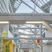 To get light into the middle of the condominium, daylighting, mixed use, real estate, roof, structure, gray