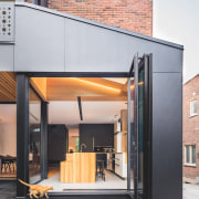 Bifold glass doors in this small addition to architecture, facade, house, gray