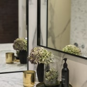Mirrors in this predominantly pale-toned bathroom by architect floristry, flower, flowerpot, furniture, home, interior design, table, vase, gray