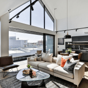 A semi-industrial look connects the interior fit-outs at house, interior design, living room, penthouse apartment, real estate, gray