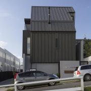 Dark-toned standing-seam aluminium cladding wraps up and down architecture, automotive exterior, building, car, facade, home, house, luxury vehicle, motor vehicle, real estate, shed, siding, vehicle, gray, teal