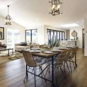 On the interior of this GJ Gardner showhome, dining room, estate, floor, flooring, hardwood, home, interior design, living room, property, real estate, room, table, white