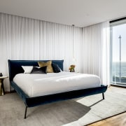 The master bedroom has its own private balcony