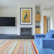 The home has an indoor Living Flame fireplace