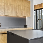Super slender benchtops feature in this modern kitchen