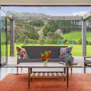 Bifold doors draw back to make the indoors gray