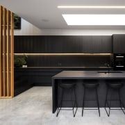 Black glass and fully integrated Miele appliances were