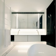 """For this bathroom, we chose a continuous Corian architecture, bathroom, bathroom accessory, bathtub, building, ceiling, floor, flooring, furniture, glass, house, interior design, material property, plumbing fixture, property, room, sink, tap, tile, white, gray"