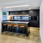 For this project, the homeowners wanted a matt apartment, architecture, building, cabinetry, ceiling, countertop, design, dining room, floor, flooring, furniture, home, house, interior design, kitchen, living room, property, real estate, room, table, gray
