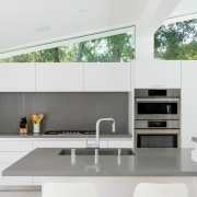 The kitchen is pared back to minimalist effect,