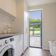 The home's generous-sized laundry and scullery are in gray