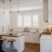 The herringbone floor and benchtops contrast and complement