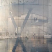 A curtain wall of fritted glass with varying architecture, atmospheric phenomenon, reflection, sky, water, gray